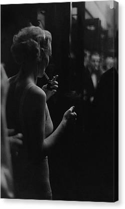 A Woman Smoking At The Music Box Canvas Print