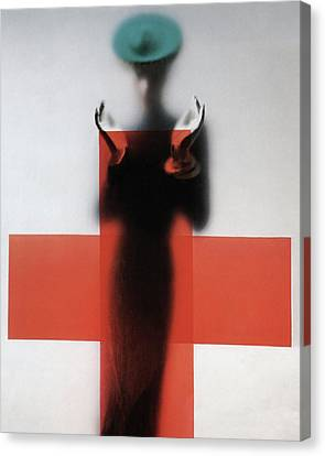 A Woman Standing Behind A Red Cross On Frosted Canvas Print by Erwin Blumenfeld
