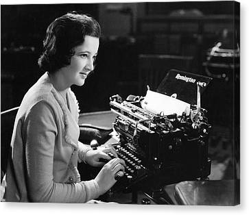 A Woman Typing Canvas Print by Underwood Archives