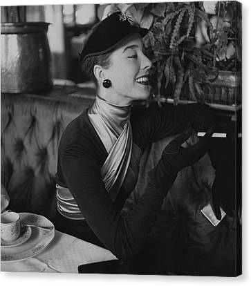 Dior Canvas Print - A Woman Wearing Dior by Henry Clarke