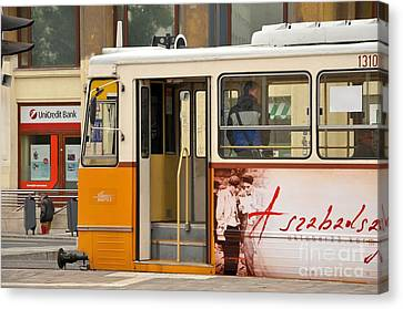 A Yellow Tram On The Streets Of Budapest Hungary Canvas Print