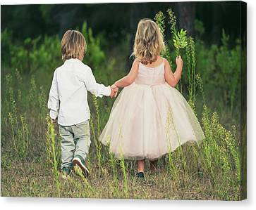 A Young Boy And Young Girl Holding Canvas Print