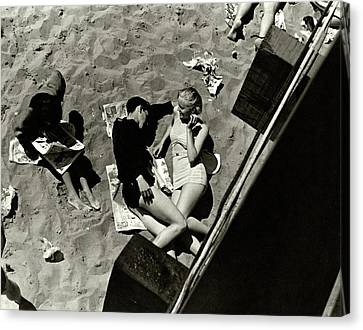 Bonding Canvas Print - A Young Couple Lying On A Beach by Lusha Nelson