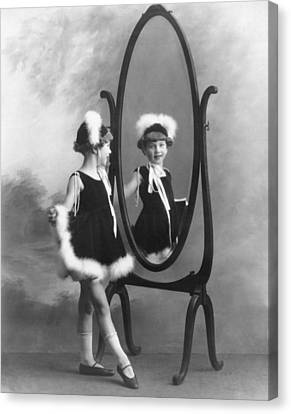 A Young Girl In A Mirror Canvas Print by Underwood Archives