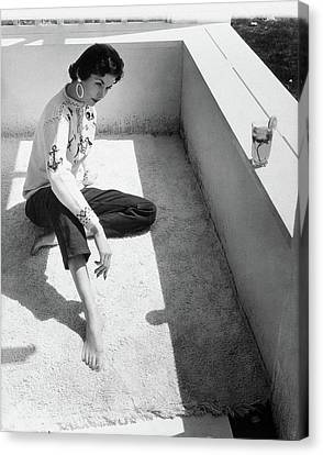 A Young Model Crouching On A Porch Canvas Print