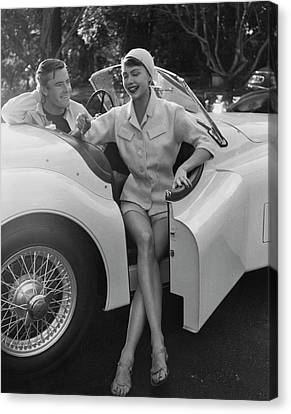 A Young Model Sitting In A Convertible Sports Car Canvas Print by Karen Radkai