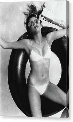A Young Woman Floating On An Inner Tube Canvas Print by Albert Watson