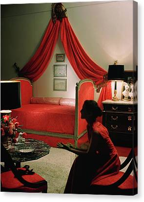 A Young Woman Sitting In A Red Bedroom Canvas Print by Horst P. Horst