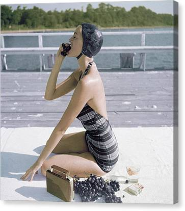 A Young Woman Wearing A Swimsuit Eating Grapes Canvas Print