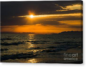 Sunset On The Mediterranian Coast Canvas Print by Peter Noyce
