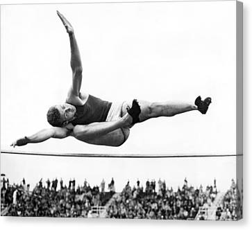 Delos Canvas Print - Aaaa Winning High Jump by Underwood Archives
