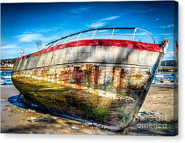 Abandoned Boat Canvas Print by Adrian Evans