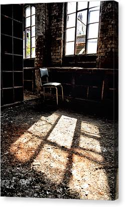 Abandoned Chair Sits In Sunlight By An Abandoned Window Canvas Print by Russ Dixon