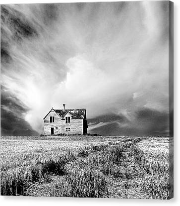 Abandoned Farm House In Stubble Field Canvas Print by Donald  Erickson