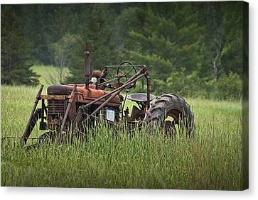 Abandoned Farm Tractor In The Grass Canvas Print by Randall Nyhof