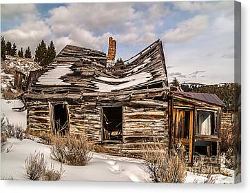 Abandoned Home Or Business Canvas Print by Sue Smith