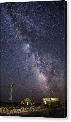 Abandoned Homestead And The Milky Way Canvas Print by Angie Vogel