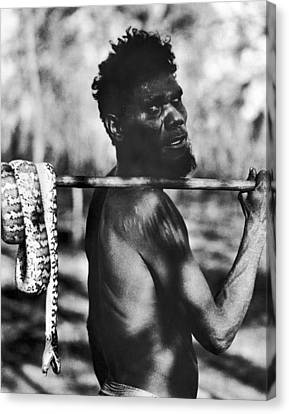 Aborigine With Snake Canvas Print by Underwood Archives