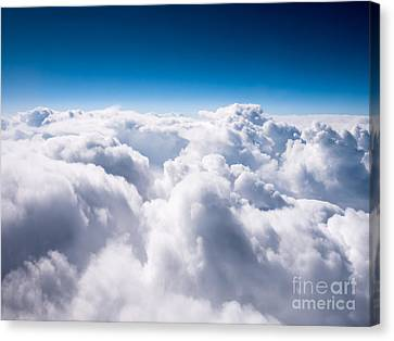 Above The Clouds Canvas Print by Paul Velgos