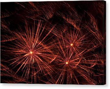 Abstract Of Fireworks On Black Canvas Print by Jess Kraft
