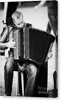 Accordion Player Playing Street Musician In Rynek Glowny Town Square Krakow Canvas Print by Joe Fox
