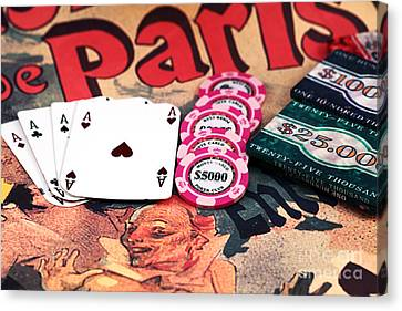 Aces In Paris Canvas Print by John Rizzuto
