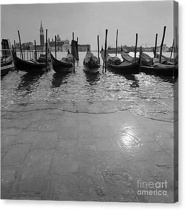 Acqua Alta A Venezia Canvas Print by Riccardo Mottola