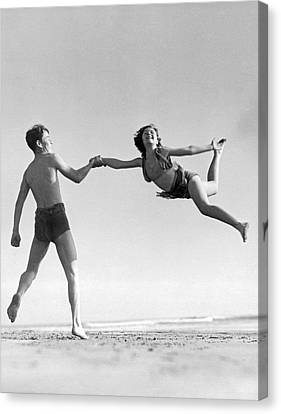 Acrobatic Beach Exhibition Canvas Print by Underwood Archives
