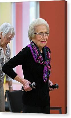 Active Elderly Lady Exercising Canvas Print