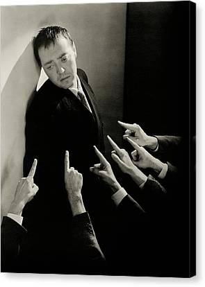 Actor Peter Lorre Posing Against A Wall Canvas Print