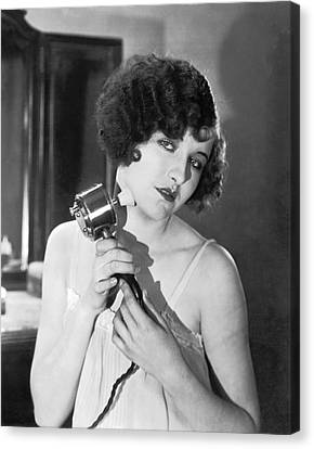 Actress Using Massage Device Canvas Print by Underwood Archives