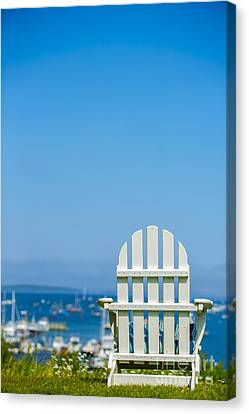 Adirondack Chair By The Sea Canvas Print by Diane Diederich