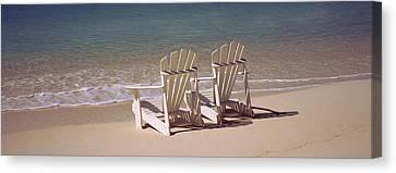 Adirondack Chair On The Beach, Bahamas Canvas Print