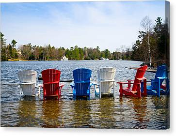 Adirondack Chairs Partially Submerged Canvas Print by Panoramic Images