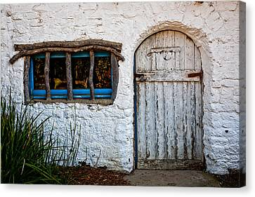 Adobe Door And Window Canvas Print by Peter Tellone