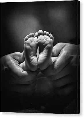 Adult Hands Holding Bare Baby Feet Canvas Print by Pete Stec