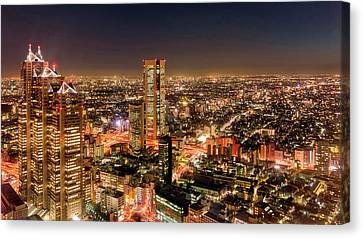 Aerial View Of A City At Night Canvas Print by Panoramic Images
