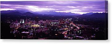 Aerial View Canvas Print - Aerial View Of A City Lit Up At Dusk by Panoramic Images