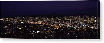Aerial View Of A City Lit Up At Night Canvas Print by Panoramic Images