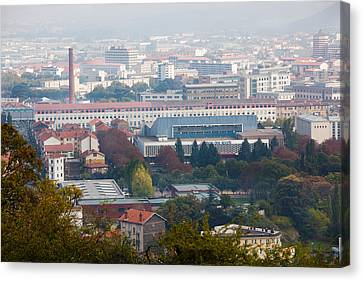 Aerial View Of City And Michelin Tire Canvas Print by Panoramic Images