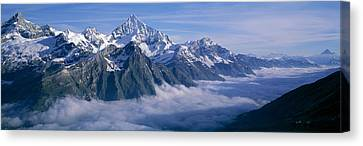 Aerial View Of Clouds Over Mountains Canvas Print