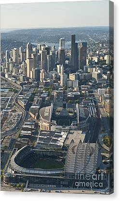 Aerial View Of Seattle Skyline With The Pro Sports Stadiums Canvas Print by Jim Corwin