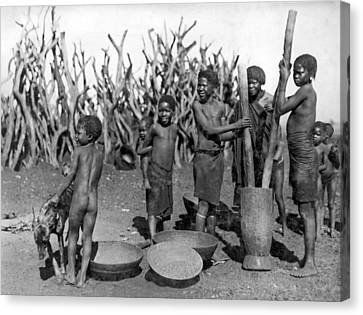 African Girls Grinding Corn Canvas Print by Underwood Archives