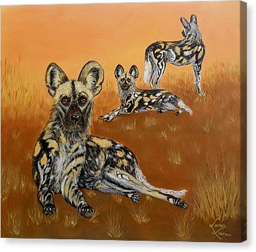 Closely Canvas Print - African Wild Dogs At Dusk by Lorna Loxton