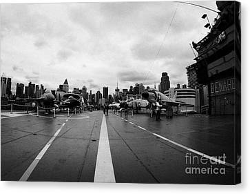 Aircraft On The Flight Deck Of The Uss Intrepid And Flight Island Looking Towards Manhattan Canvas Print by Joe Fox