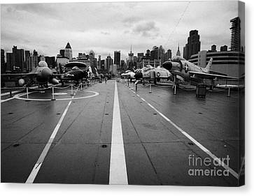 Aircraft On The Flight Deck Of The Uss Intrepid Looking Towards Manhattan New York Canvas Print by Joe Fox