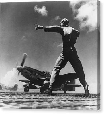 Airman Gives The Take Off Signal Canvas Print by Everett