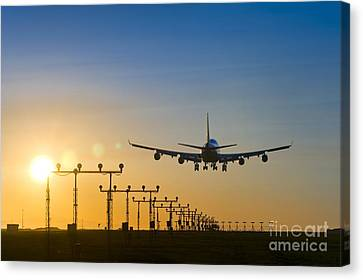 Airplane Landing At Sunset, Canada Canvas Print