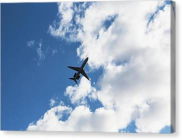 Airplane Leaving Anchorage Airport Canvas Print by LJM Photo