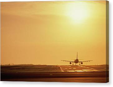 Air Travel Canvas Print - Airplane On Runway by Panoramic Images